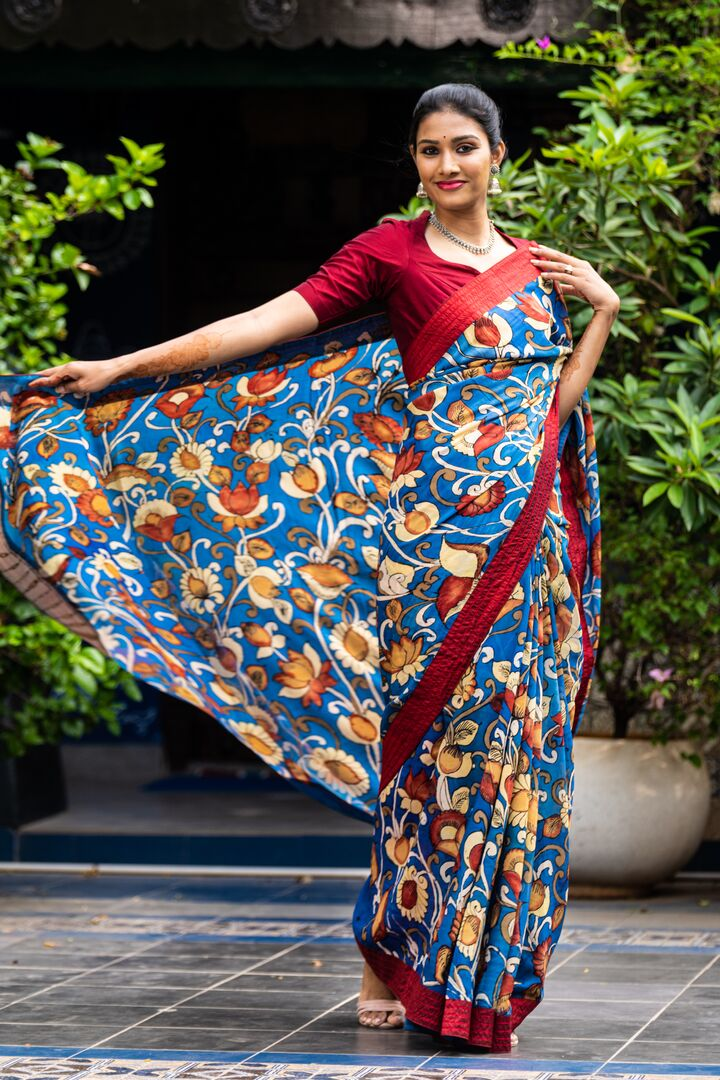 Georgeous Hand Painted Signature Kalamkari With Floral Motifs All Over And Silk Border Attached