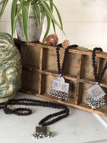 Indian Rudraksha Mala prayer beads with metal charm
