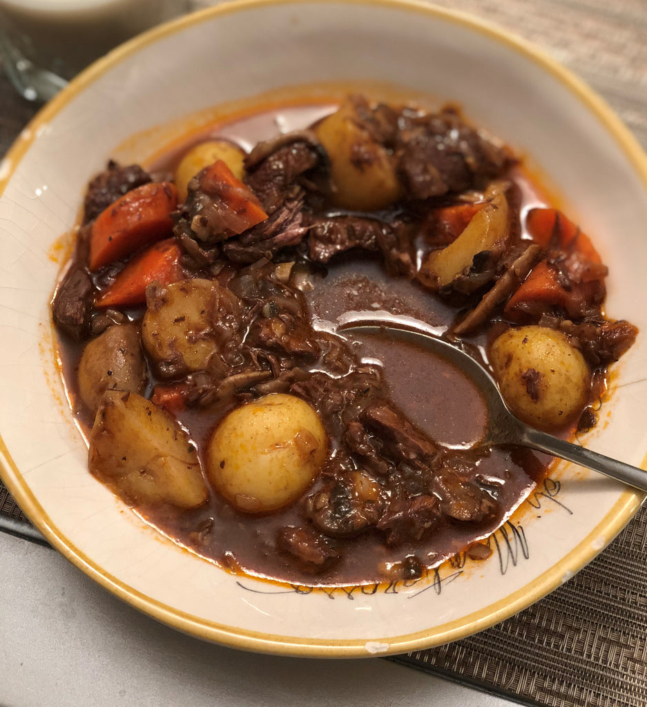 Classic beef stew with savory gravy, potatoes, and carrots.