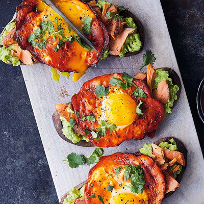 Avocado toast slices with salmon, egg, and turmeric