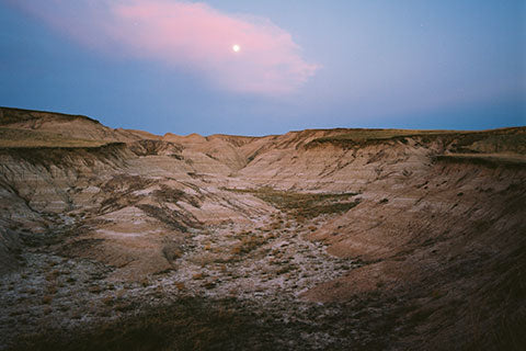 Badlands landscape with moon