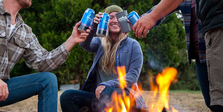 Friends around campfire with Patagonia Provisions beer