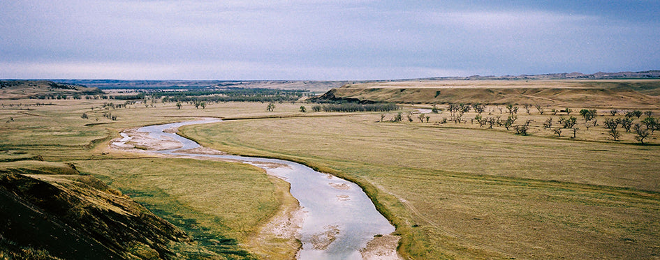 Water running through prairie land