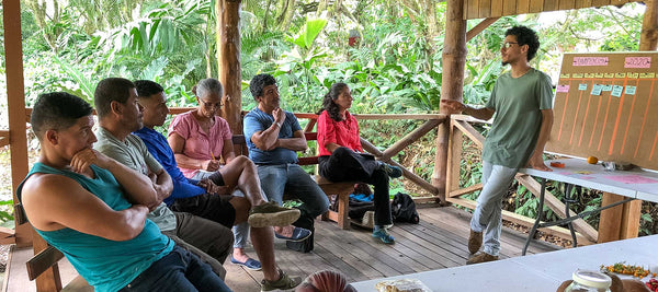 Founder of Jungle Foods teaching a workshop in an outdoor classroom