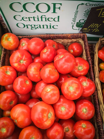 A basket of organic tomatoes at the farmers' market