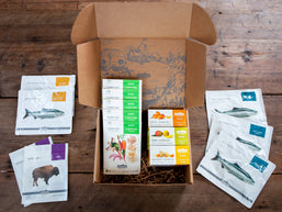 Patagonia Provisions open Deluxe Gift Box with Buffalo Jerky, Sockeye Salmon, Fruit + Almond Bars and Tsampa