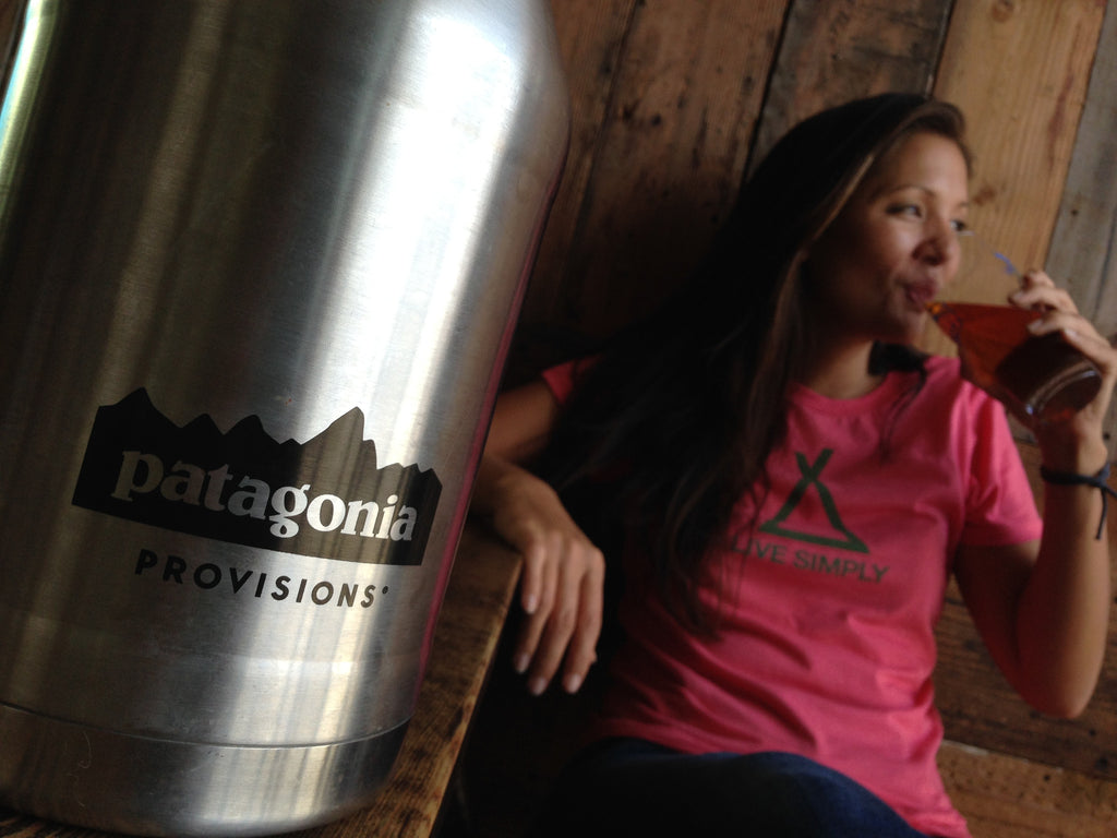 Stainless MiiR® double walled growler with Patagonia logo and woman sitting in the background