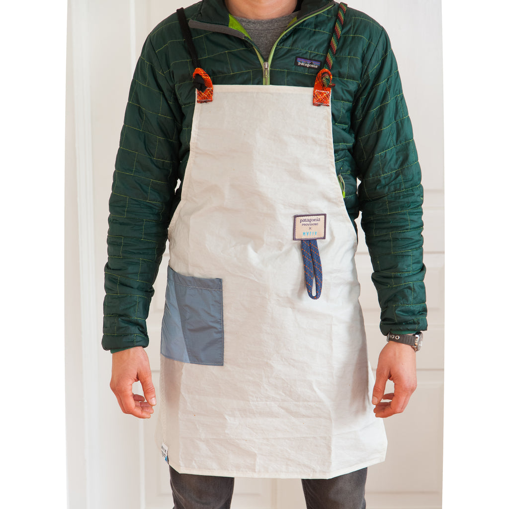 Person wearing Mafia Upcycled Apron in front of white background.