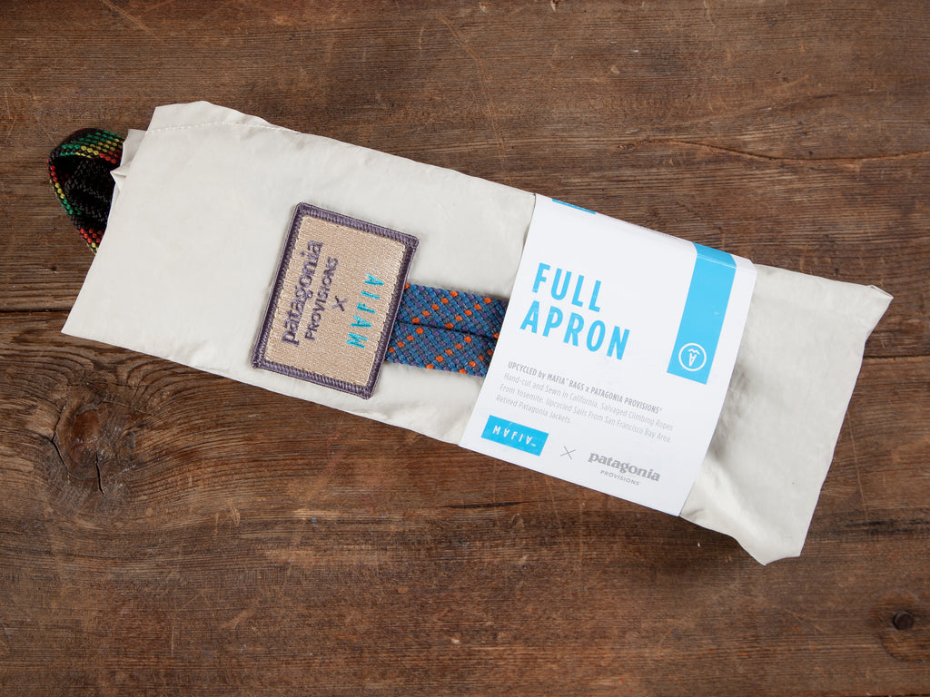 Upcycled Apron packaging on wooden background.