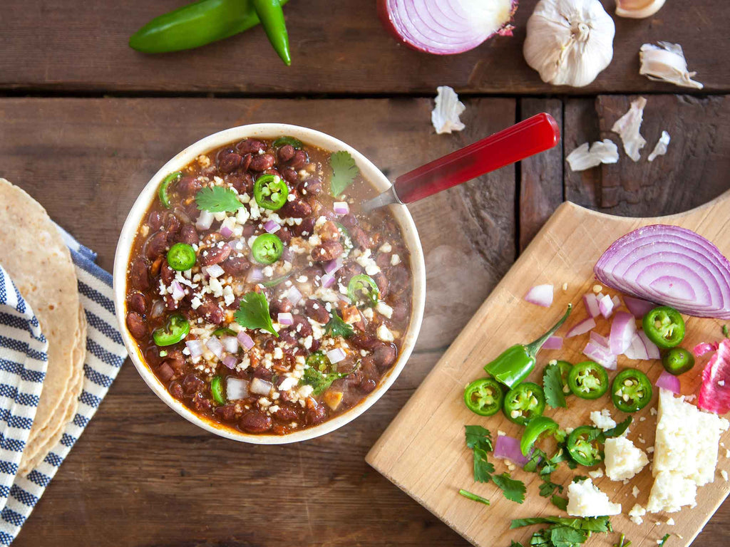 Red Bean Chili prepared in a bowl on wood background.