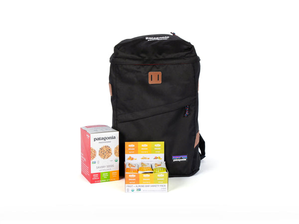 Black Patagonia backpack with organic energy bars and savory seeds perfect for backpacking