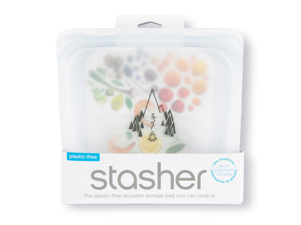 Stasher Reusable Silicone Stand Up bag in packaging, clear color with campfire logo