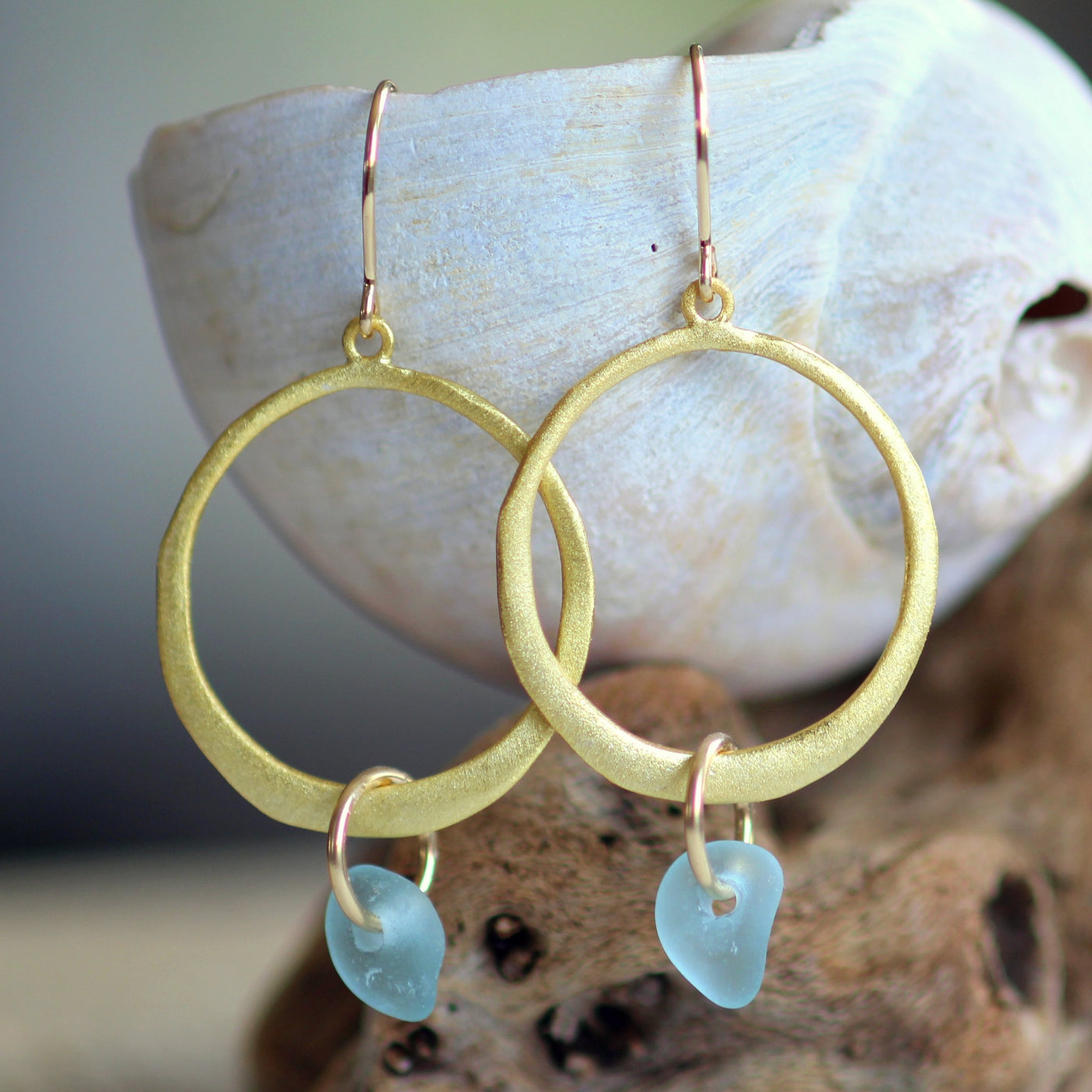 Verge gold sea glass earrings crafted with genuine aqua sea glass