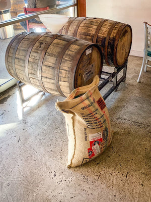 coffee aging in Bourbon Barrels that once held Smog City Brewing's Infinite Wishes