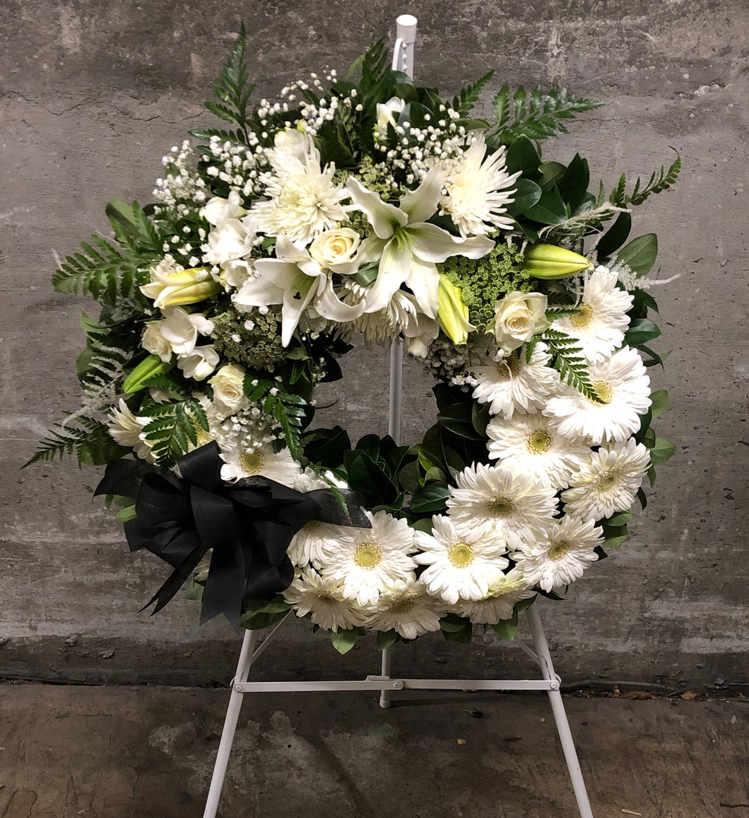 Classical white funeral wreath