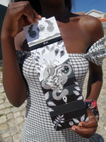 black skin girl holding a limited edition of artist papes
