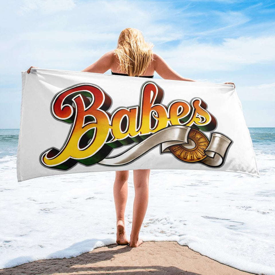 blond girl holding a a towel with babes papes logo