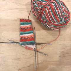 Double pointed needle technique for knitting socks