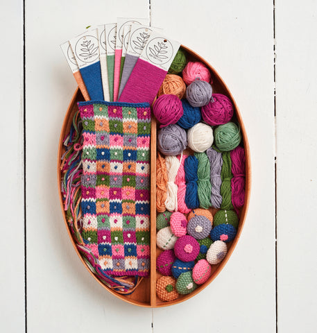 Basket of knitted swatches and covered buttons