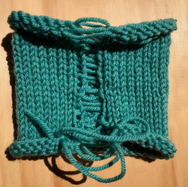 Teal knitted swatch in the round