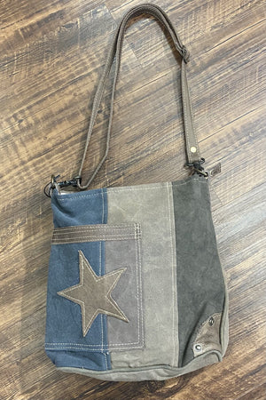 Star on denim shoulder bag