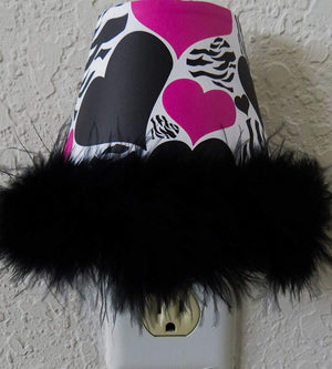 Zebra Priint Heart Night Lights in Hot Pink and Black with a Black Boa At Bottom