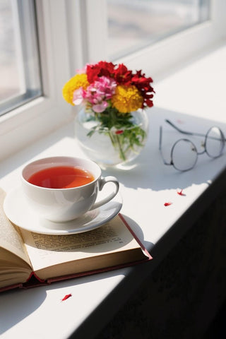 drinking hibiscus tea from a white teacup
