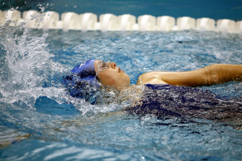 Still image of woman swimming in a swimming pool