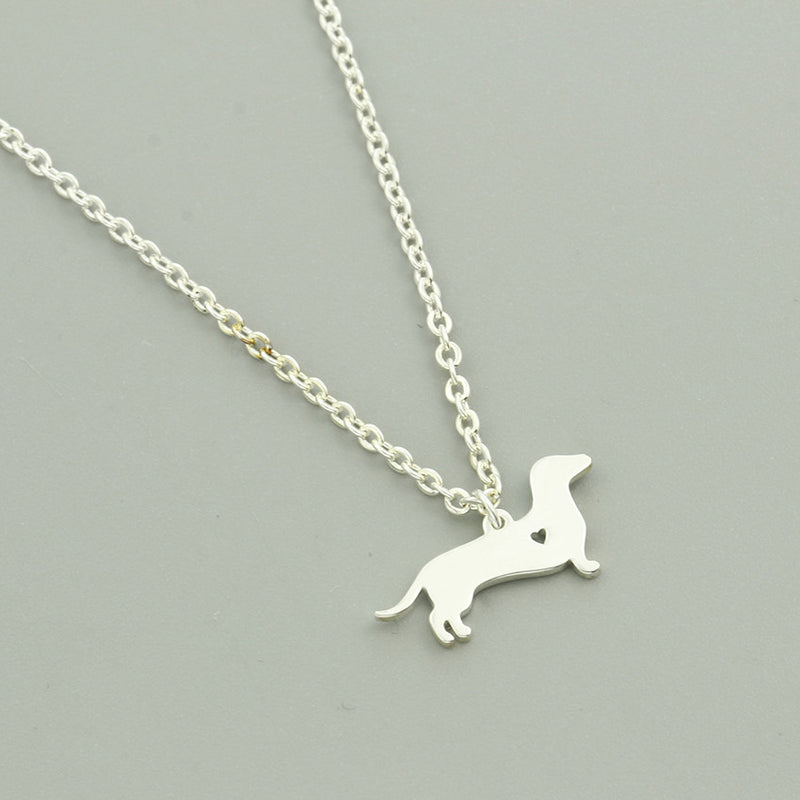 Dachshund / Sausage Dog Pendant with Mini Cut Out Heart Detail on Chain Necklace in Gold or Silver Color