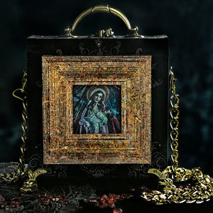 Virgin and child on black and gold velvet hand bag