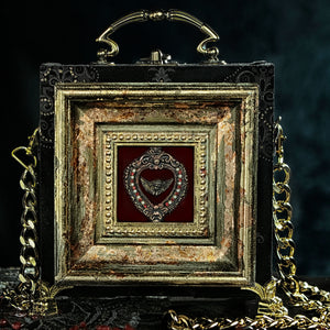 Victorian black and gold velvet with framed heart and angel hand bag