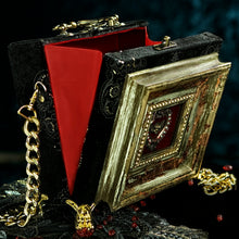Load image into Gallery viewer, Victorian black and gold velvet with framed heart and angel hand bag