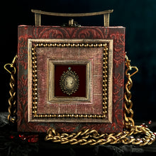 Load image into Gallery viewer, Framed victorian cameo on red and cyan brocade hand bag