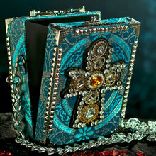 Load image into Gallery viewer, Yellow and clear rhinestones cross applique on turqoise brocade hand bag