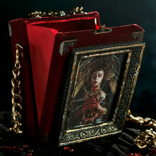 Load image into Gallery viewer, Framed Virgin of Sorrows on red velvet hand bag