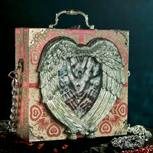 Load image into Gallery viewer, Elizabeth's hands in a hand carved heart frame hand bag