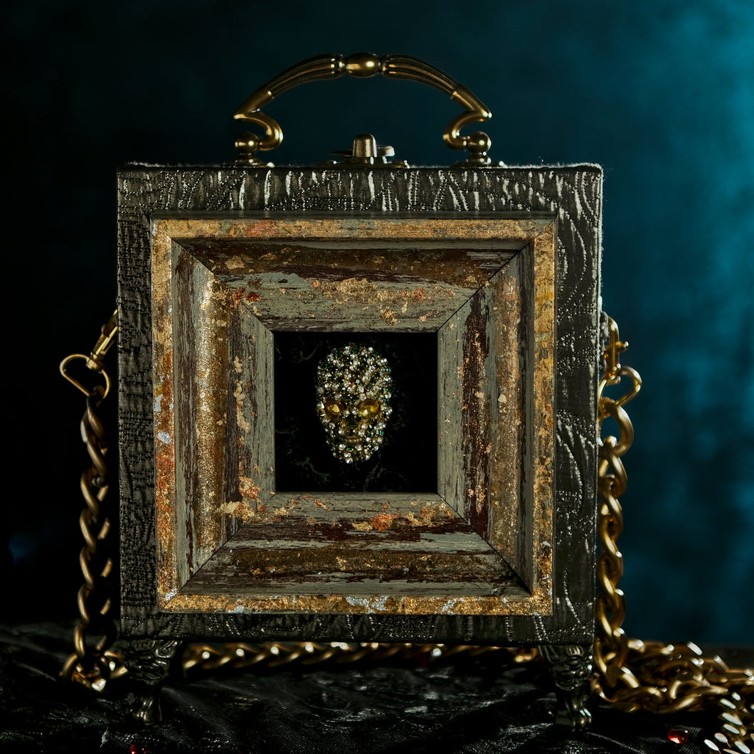 Rhinestones skull framed on a bronze brocade hand bag