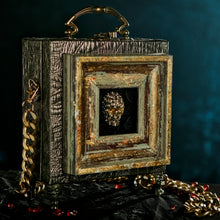 Load image into Gallery viewer, Rhinestones skull framed on a bronze brocade hand bag