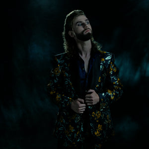 Tailored jacket in a blue and yellow brocade