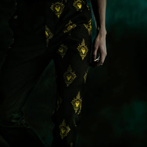 Black trousers with yellow golden sacred hearts