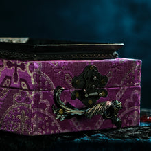 Load image into Gallery viewer, Framed raven head on purple and silver brocade hand bag