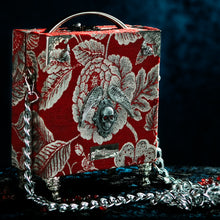 Load image into Gallery viewer, Framed Bloody Mary on a red brocade handbag