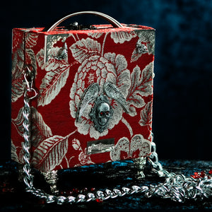 Framed Bloody Mary on a red brocade handbag