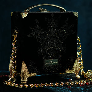Framed Kali mouth on black velvet brocade hand bag