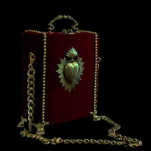 Gold sacred heart on velvet hand bag