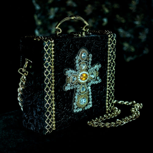 Yellow and clear rhinestones cross on black velvet hand bag