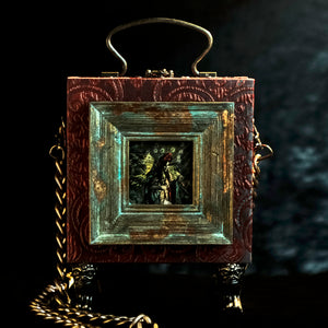 Framed Virgin of Quito on a red and cyan brocade