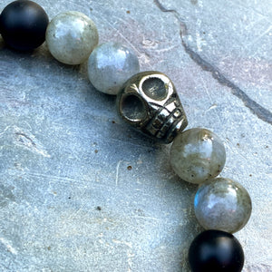 Matte onyx, pyrite skull, and labradorite gemstone stretch bracelet