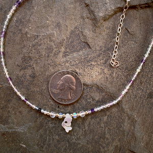 Mother of pearl mermaid on rainbow fluorite with Ethiopian opals, white topaz and sterling silver.