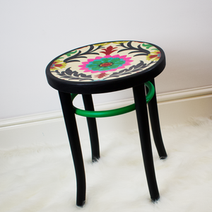 Bentwood stool refinished in boho-chic style featuring Autentico paint Nocturnal and Bright Green.